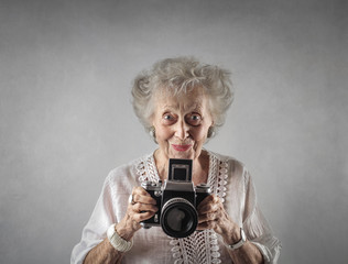 Elderly lady taking a picture