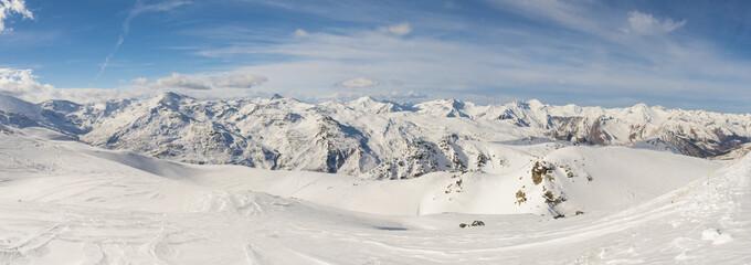 Panoramic view of mountain range with ski piste