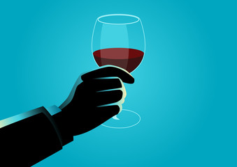 Hand holding a wine glass