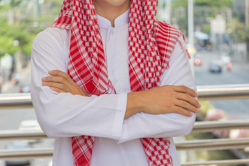 Arab businessman thinking or entrepreneur looking in the city