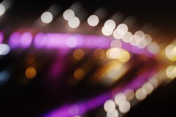 Blurred background of night city lights - lens-bokeh of a night skyline riverside