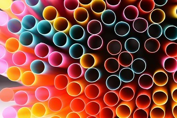 Drinking straws. Macro abstract image with beautiful multi-colored background.