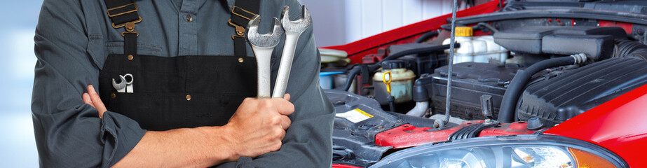 Hands of car mechanic with wrench