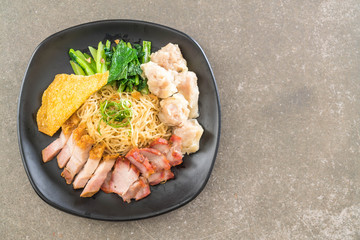 Egg noodle with red roast pork, crispy pork, dumplings and soup