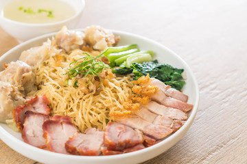 Egg noodle with red roast pork, crispy pork, dumplings and soup