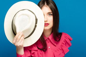 Beautiful woman in hat. Retro fashion. Blue Background.