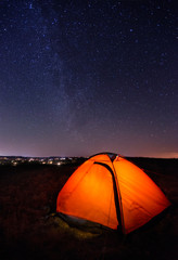 Tourist tent at the night under the starry sky
