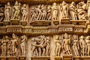 Close up of artful ancient carvings, Khajuraho Group of Monuments, India