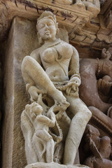 Close up of artful ancient sculptures, Khajuraho Group of Monuments, India
