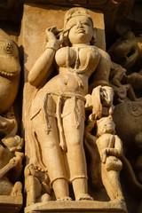 Close up of artful ancient sculpture, Khajuraho Group of Monuments, India