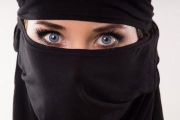 Portrait of a woman wearing a mask.