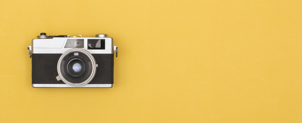 retro photography camera on colored background