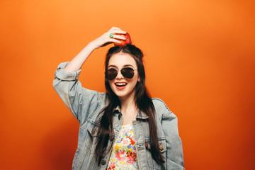 Beautiful teen girl. Hippy. orange background