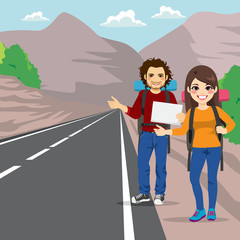 Couple with backpack hitchhiking standing on road side