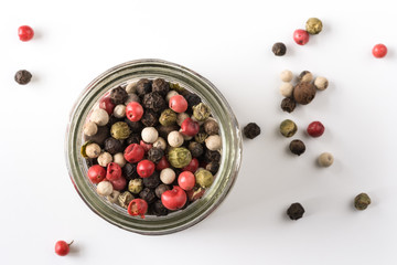 Whole peppercorns in a spice jar