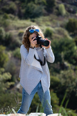 Photographer woman in gray jacket and jeans