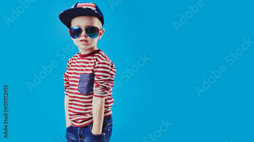 592dd63db Cute little boy in elegant clothes and sunglasses. Kids fashion ...