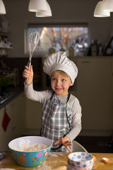 Aha! Little chef has found his whisk