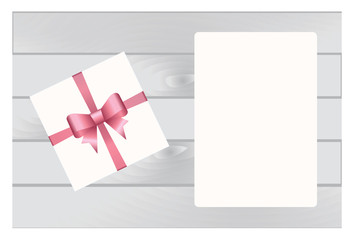 White Square Gift Box with Pink Bow and White Sheet of paper Isolated on Wooden Plank Background.  Has place for your text. Vector image.