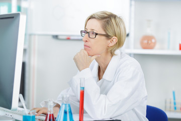 concentrated scientist doing scientific experiment in laboratory