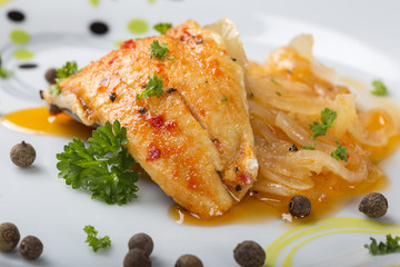 Close up of marinated fish with herbs
