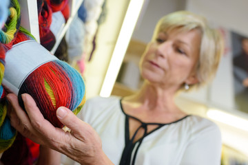 Woman choosing ball of wool