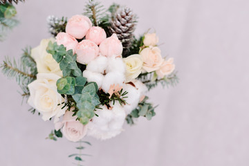 Tender wedding bouquet of roses, cone and cotton, closeup