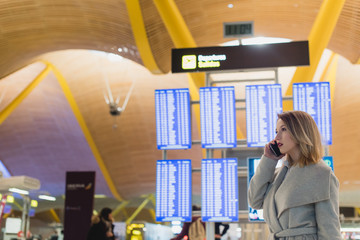 Woman talking phone in the airport
