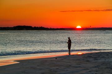 fisherman in the setting sun