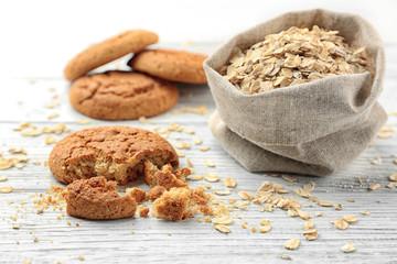 Deurstickers Koekjes Diet cookies with oatmeal on white wooden background