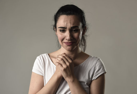 beautiful and sad woman crying desperate and depressed with tears on her eyes suffering pain