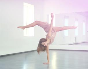 Beautiful young woman dancing in studio