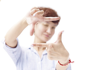 asian woman framing a picture with hands