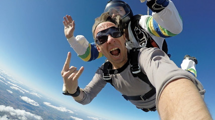 Wall Murals Sky sports Selfie skydiving tandem