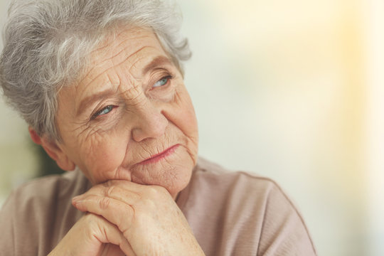 Depressed elderly woman at home