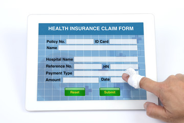 Wall Mural - Health insurance claim form on tablet.