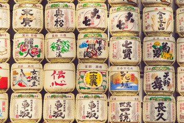 TOKYO, JAPAN - MARCH 30: A collection of Japanese sake barrels stacked is at the Japanese Meiji Shrine.
