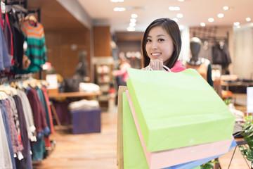 young asian woman shopping in modern shopping mall