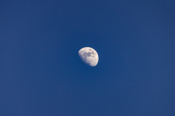 background of blue sky and a half moon