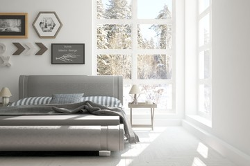 White bedroom with winter landscape in window. Scandinavian interior design
