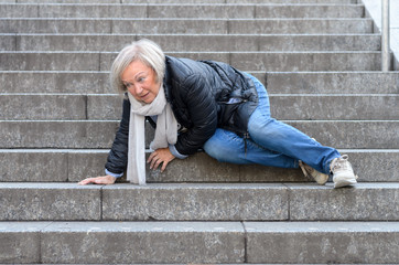 Obraz Senior woman falling down stone steps outdoors - fototapety do salonu