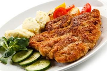 Fried pork chop, puree and vegetables