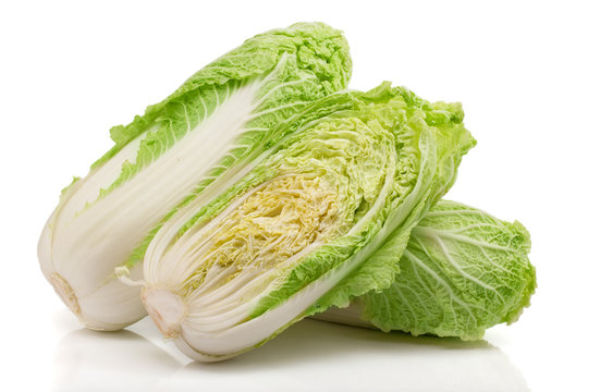 two chinese cabbage and half isolated on white background