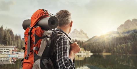 Hiker contemplating a beautiful panorama Wall mural