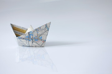 right course, paper boat, road map on board, open infinite space, freedom navigation