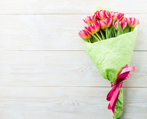 bouquet of tulips on a white wooden background. View with copy space