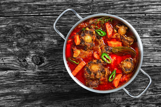 oxtail stew with vegetables, herbs, red wine