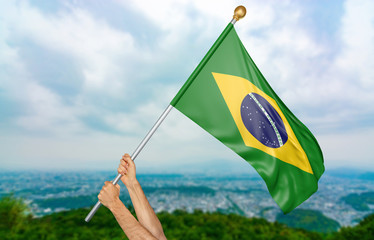 Young man's hands proudly waving the Brazil national flag in the sky, part 3D rendering