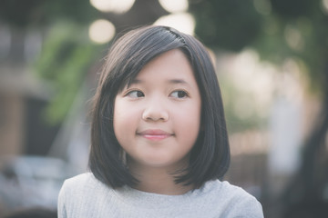 little asian girl look at side
