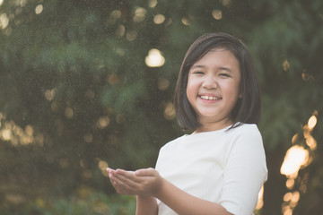 asian girl is happy with the rain